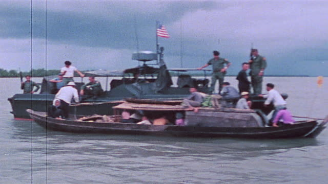 pbr alongside sampan and soldiers searching boat / vietnam - sampan stock videos & royalty-free footage