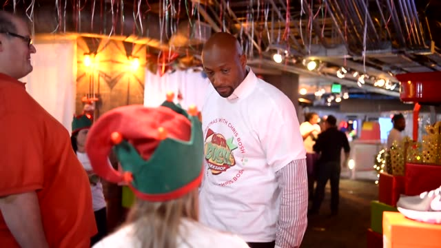 Alonzo Mourning at Christmas With Chris Bosh At 'Santa Bosh's Workshop at Game Time at Sunset Place on December 17 2012 in Miami Florida Alonzo...