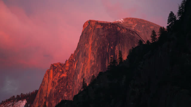 alpenglow light on half dome - yosemite national park stock videos & royalty-free footage