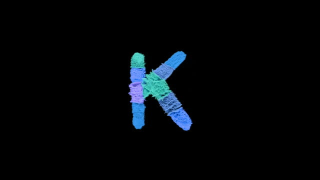 alphabet k created with powder in cold colors exploding towards camera in super slow motion and closeup on black background - futuristic stock videos & royalty-free footage