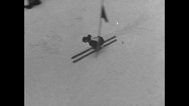 us alpine ski racer andrea mead lawrence descends down slalom course at 1952 winter olympics in oslo / lawrence speeds down the 509 yard course... - bobsleighing stock videos & royalty-free footage
