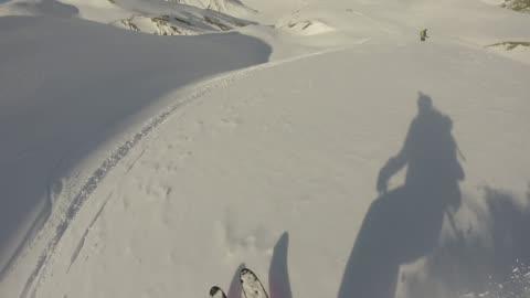pov of alpine skier descending powder slope - five people stock videos & royalty-free footage