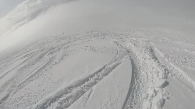 pov of alpine skier descending powder slope - ski slope stock videos and b-roll footage