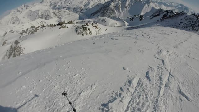pov of alpine skier descending powder slope - summit stock videos & royalty-free footage