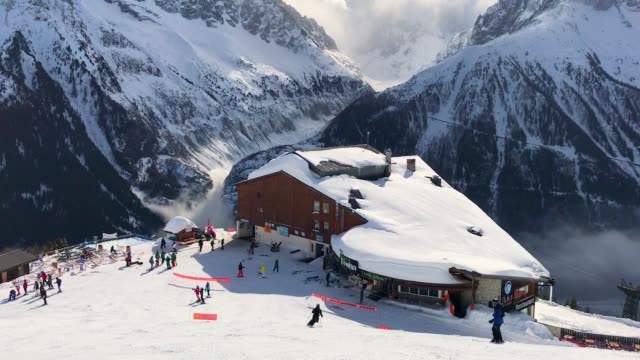 Alpine skiers gather at a restaurant at Le Brevent ski resort on February 24 2018 near ChamonixMontBlanc France The French Alps are a popular...