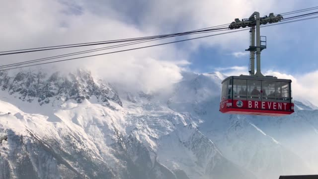 Alpine skiers travel on the cable car ski in Brevent summit on February 23 2018 near ChamonixMontBlanc France The French Alps are a popular...