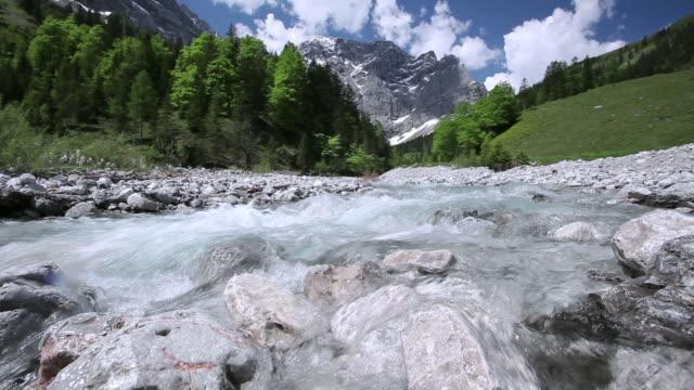 la alpine stream flowing in the grosser ahornboden valley / tyrol, austria - european alps stock videos & royalty-free footage