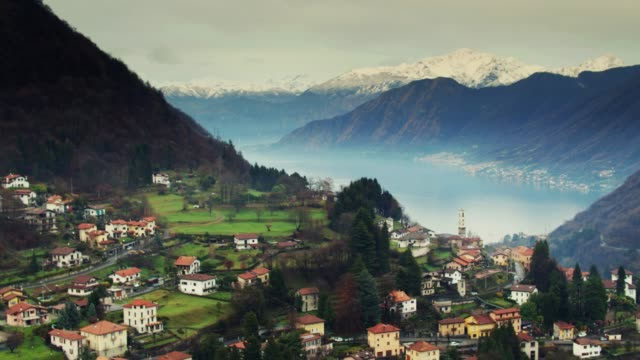 Alpine Village with Lake Como Reveal - Drone Shot