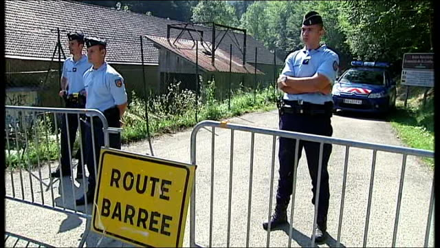 french police officers head to london to pursue investigation low angle view police officer standing at road barrier behind 'route barree sign'... - hands behind head stock videos & royalty-free footage