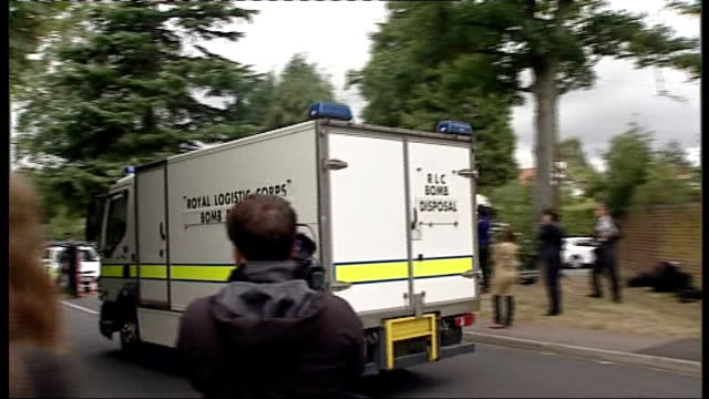 Police talk to seven year old survivor and reveal details of shooting ENGLAND Surrey Claygate EXT Police officers standing alongside police vehicle...