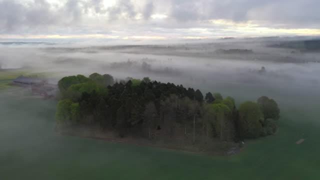 alstad spring fog scenery / alstad, sweden - sweden stock-videos und b-roll-filmmaterial