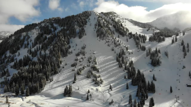 alta ski area in the peak of winter season near salt lake city utah in the wasatch mountain range - chalet video stock e b–roll