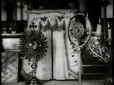 vídeos y material grabado en eventos de stock de alter of shrine of the little flower church w/ radio microphone standing fg. int church w/ empty pews. - 1933