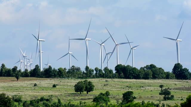 stockvideo's en b-roll-footage met alternative energy wind turbines - cross processen