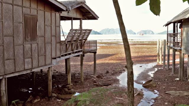 alternative homes over water stilt house - stilt house stock videos & royalty-free footage