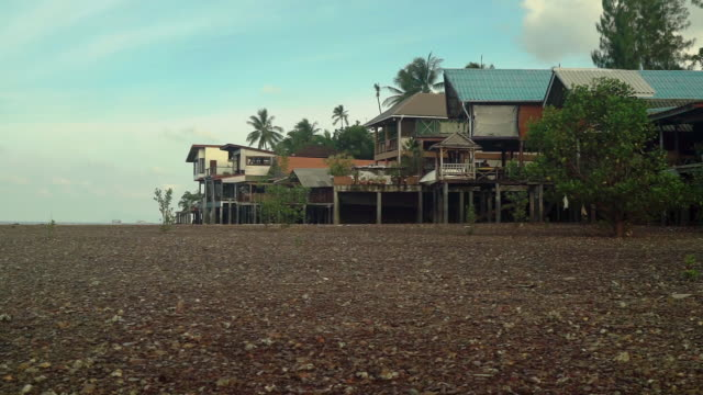 alternative homes traditional stilt houses on waterfront - tradition stock videos & royalty-free footage