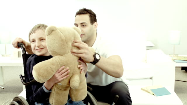 alternative therapy for a child - paralysis stock videos & royalty-free footage