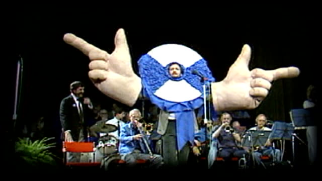Celebrity support LIB 1983 Comedian Kenny Everett with huge pair of hands appearing at Conservative Party conference GRAPHICISED SEQUENCE Steve Davis...