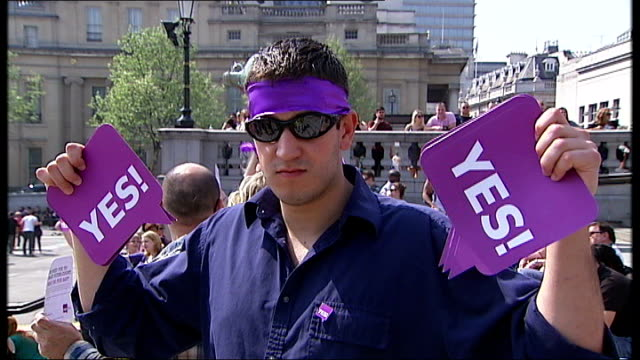 coalition cracks widen london trafalgar square various shots of alternative vote 'yes' supporters holding up 'yes' placards and banners at 'flash... - flash mob stock videos and b-roll footage