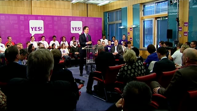 alternative vote referendum: 'yes' campaign event: general views; int cutaway gvs of ed miliband making speech / close shot of 'yes' logo on backdrop... - vince cable stock videos & royalty-free footage