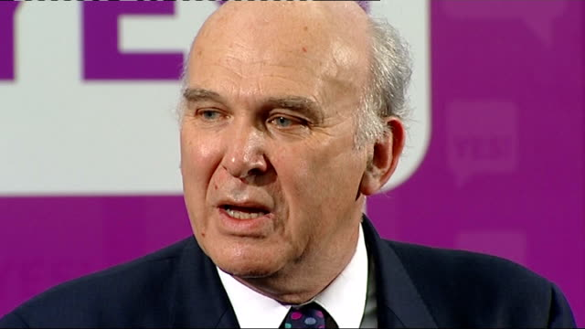 'Yes' campaign event general views 'Yes' supporters in audience applauding / CUTAWAY GVs Vince Cable making speech / GV Ed Miliband listening to...