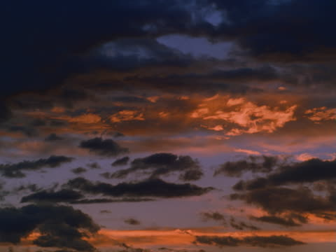 altocumulus and cirrus clouds at sunset - altocumulus stock videos and b-roll footage