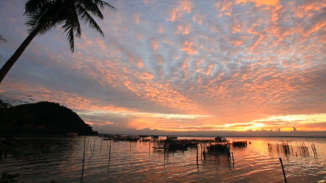 altocumulus at sunset in tropical zone. - kameraåkning med kran bildbanksvideor och videomaterial från bakom kulisserna