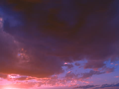 altocumulus clouds with pink and red sunset afterglow - altocumulus stock videos and b-roll footage