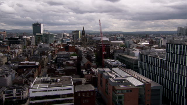 altostratus clouds loom over the city of manchester england. available in hd. - manchester england stock videos & royalty-free footage