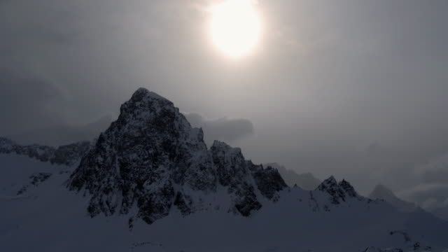 M1 Altostratus clouds obscure the sun as they pass over the Col des Ves in the Réserve Naturelle de Tignes-Champagny