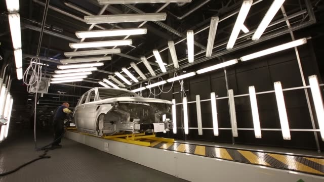aluminium body sections of the range rover sport automobile move along the assembly line at the jaguar land rover plc plant in solihull uk on... - plc stock videos & royalty-free footage