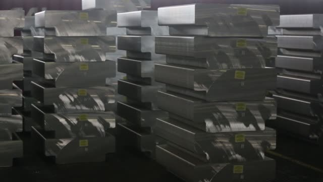 Aluminium ingots branded with the Rusal company logo sit in the foundry at the Khakas aluminium smelter operated by United Co Rusal in Sayanogorsk...