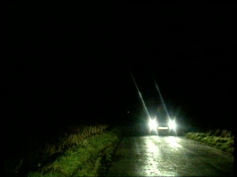 night track along country road where murder occurred day airv of scene of stabbing lib redditch andrews crying at pkf - kommode stock-videos und b-roll-filmmaterial