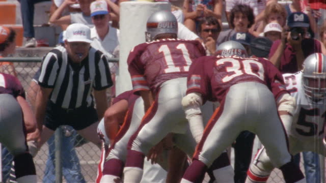 1985 WS PAN Alvin Bailey of Tampa Bay Bandits missing football pass during game against Jacksonville Bulls / Jacksonville, Florida, USA