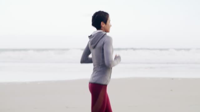 i always enjoy my beach runs - self discipline stock videos and b-roll footage