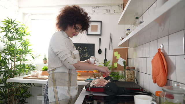 always happy in kitchen - seasoning stock videos & royalty-free footage