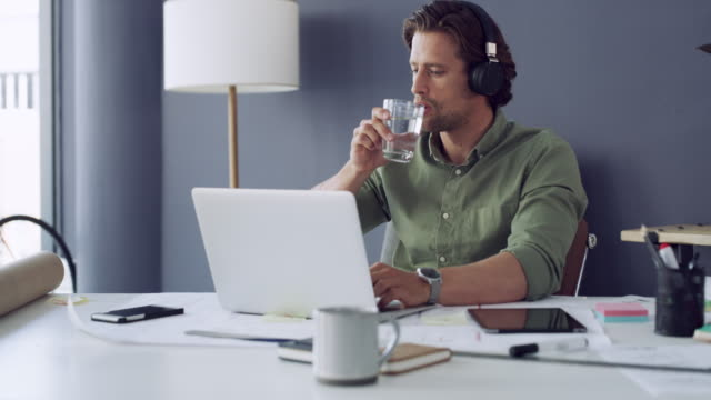 always stay hydrated while you work - drinking water stock videos & royalty-free footage