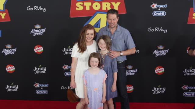 Alyson Hannigan and Alexis Denisof at the World Premiere of Toy Story 4 at El Capitan Theatre on June 11 2019 in Los Angeles California