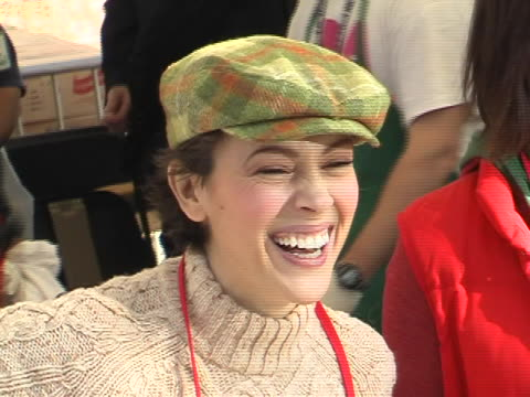 Alyssa Milano and Jennifer Love Hewitt at the Celebrities Reach Out to Homeless at the Los Angeles Mission at Los Angeles Mission in Los Angeles...