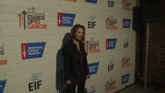 alyssa milano at hollywood stands up to cancer on in los angeles california - alyssa milano stock videos & royalty-free footage