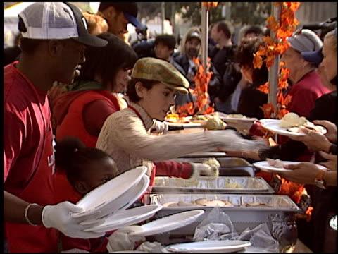 alyssa milano at the celebrity thanksgiving at los angeles mission in los angeles california on november 26 2003 - alyssa milano stock-videos und b-roll-filmmaterial