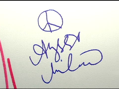 alyssa milano's autograph at the red party benefiting the life through art foundation at the shrine auditorium in los angeles california on december... - alyssa milano stock-videos und b-roll-filmmaterial