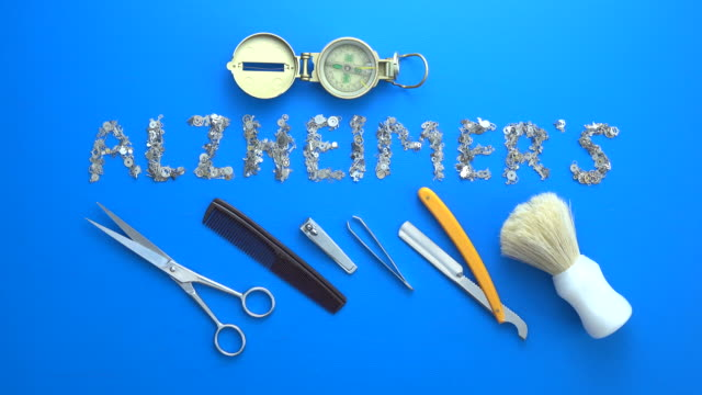alzheimer's disease concept via clockworks on blue background - razor stock videos & royalty-free footage