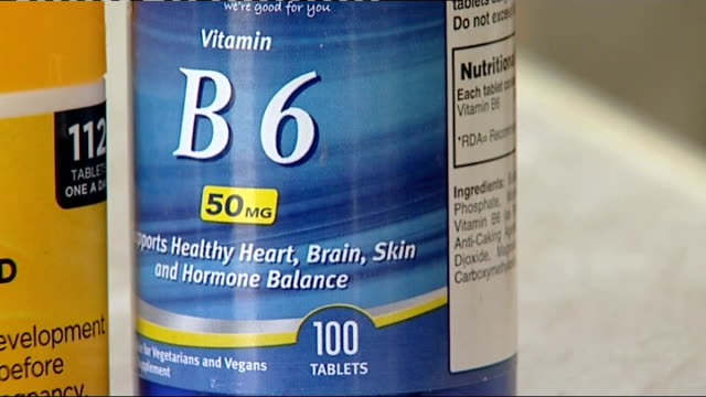 Alzheimer's Disease High doses of Vitamin B may reduce the onset of the disease Vitamin containers ENGLAND Oxfordshire Banbury INT Container holding...