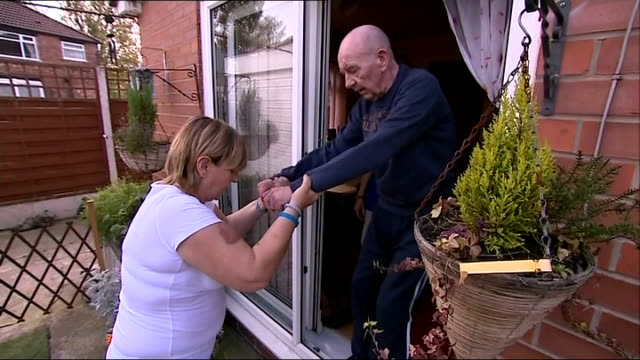 Alzheimer's Society claim the cost of care is like a 'dementia tax' Low angle view Bill and Viv Galley and reporter chatting on sofa Viv Galley...