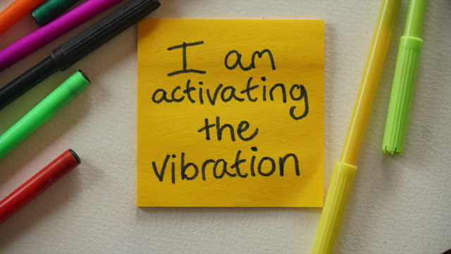 """""""i am activating the vibration that lets things in"""" affirmation notes - sticky stock videos & royalty-free footage"""