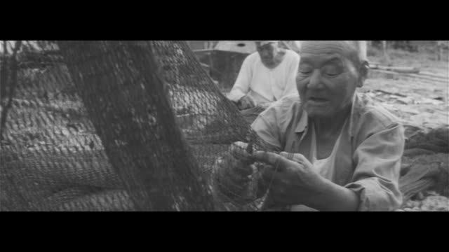 amakusa bream nets/fishermen working to get their nets ready shipping out to the ariake sea in the morning bream gathered to spawn are the prey... - ariake sea stock videos and b-roll footage