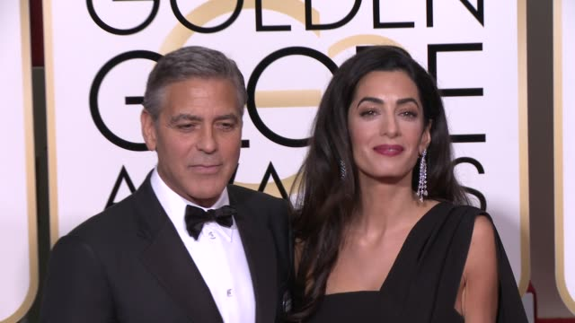 amal alamuddin clooney and george clooney at the 72nd annual golden globe awards - arrivals at the beverly hilton hotel on january 11, 2015 in... - ジョージ・クルーニー点の映像素材/bロール