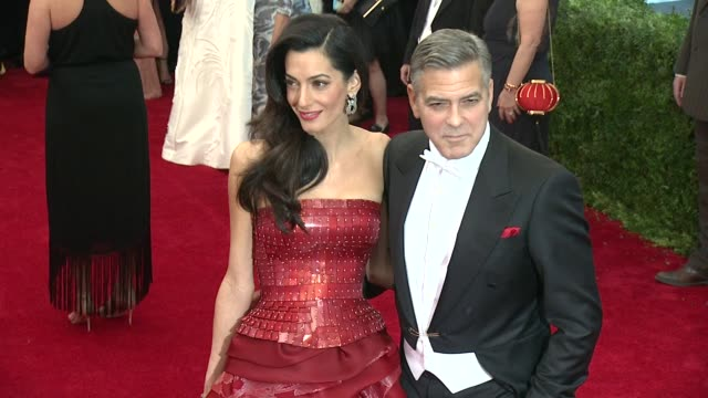 "amal clooney and george clooney at ""china: through the looking glass"" costume institute benefit gala - arrivals at metropolitan museum of art on may... - ジョージ・クルーニー点の映像素材/bロール"