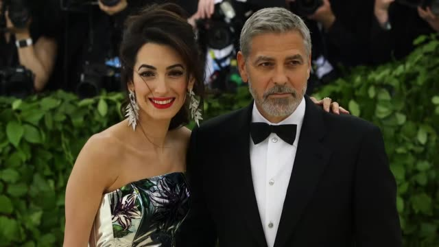 amal clooney and george clooney at heavenly bodies: fashion & the catholic imagination costume institute gala at the metropolitan museum of art on... - ジョージ・クルーニー点の映像素材/bロール